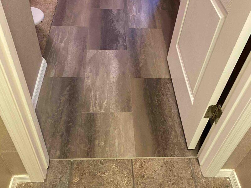 Coretec Tile in Master Bedroom Traffic Lane by FloorMaven.com