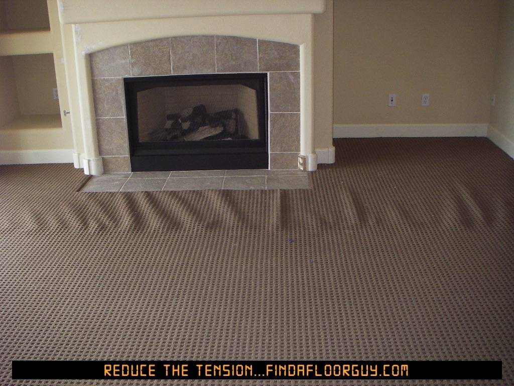 Carpet pattern matched causing uncorrectable wrinkling.