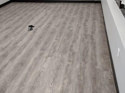Vinyl plank on floors and walls.